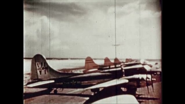 1940s: UNITED STATES: pilotless plane takes off. Drone plane. Plane in sky. Clouds in sky