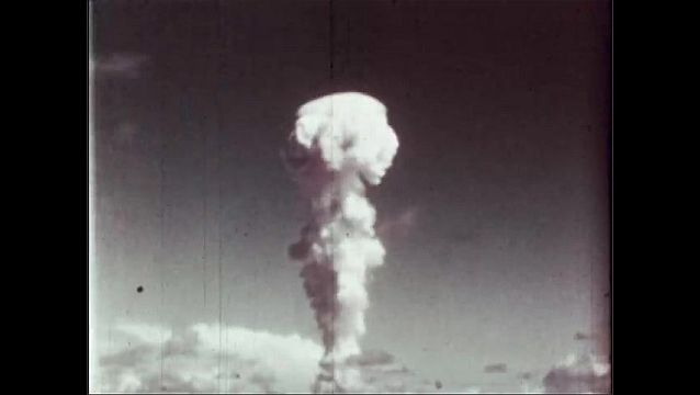 1940s: UNITED STATES: blast view from tower on Bikini. Towering cloud column at height of 8 miles.