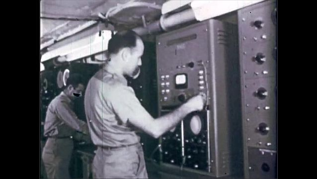 1940s: UNITED STATES: master transmitter switch in laboratory Radio transmitters and scientific apparatus in laboratory