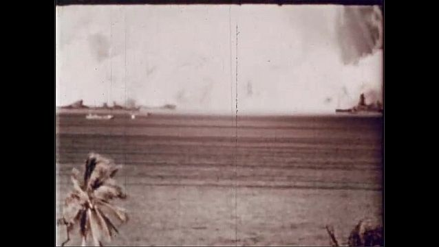 1940s: UNITED STATES: observer watches explosion through binoculars. Column of air and water explosion. Base of column.
