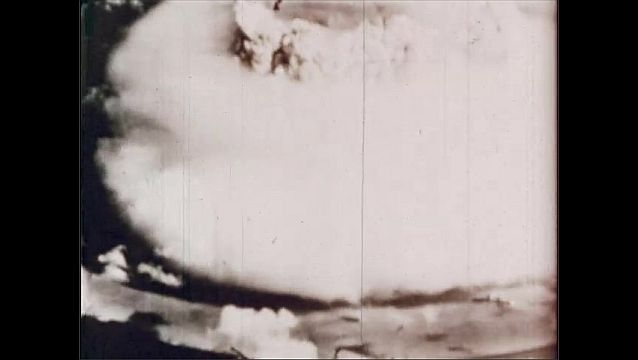 1940s: UNITED STATES: explosion and mushroom cloud seen from above.