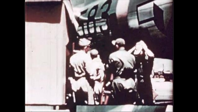 1940s: UNITED STATES: team remove cameras and film from plane for processing. New York ship. Ships sprayed to reduce contamination.