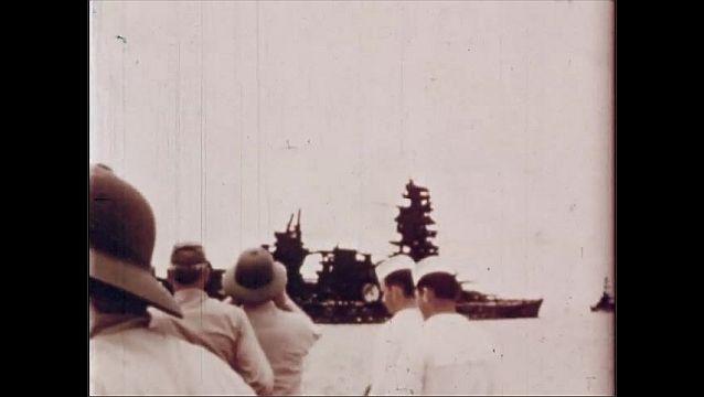 1940s: UNITED STATES: observers visit ship after blast. Admirals survey damaged ships. Japanese ship after blast.