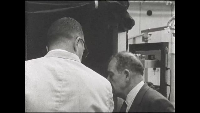 1960s: UNITED STATES: tour of generator. Visitor to experimental hall.
