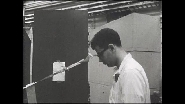 1960s: UNITED STATES: man turns on high volt. Students start test.