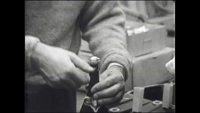 1960s: UNITED STATES: researcher opens bottle of champagne. Team open bottle.