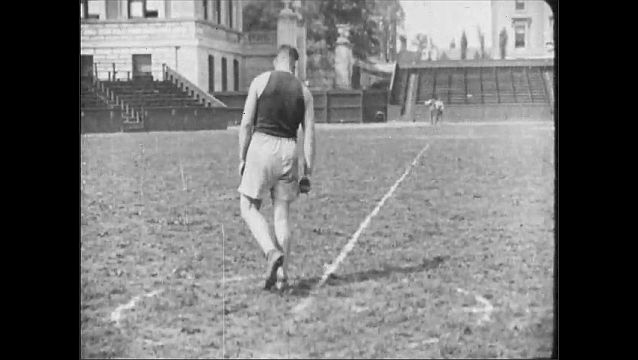 1910s: UNITED STATES: man throws discus outside building. Man throws javelin