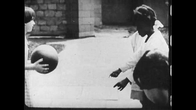 1910s: UNITED STATES: girl catches ball. Girl bounces ball. Girl drops ball.