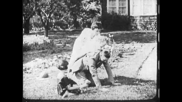 1910s: UNITED STATES: lady puts child on man's back. Man plays with children in garden. Man gives rides to children