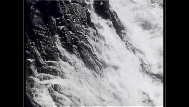 1950s: Ocean waves break on the shore. Waves crash against the rocks. Waves crash against the California shore.