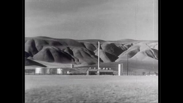1950s: Car drives past farms and rows of plants. Car drives past large farm and mountains. Woman drives car and speaks. Man looks from passenger seat.