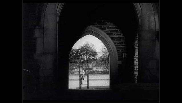 1950s: Men walk through archway. Man sits on wall, sketches, men look over his shoulder. Men play tennis. Men run around on field.