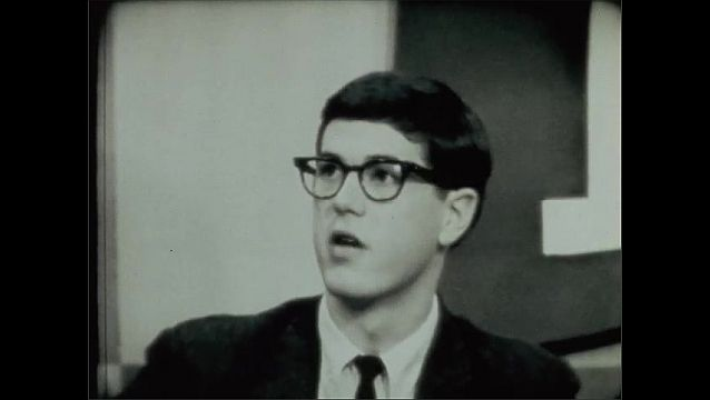1950s: Man talks.