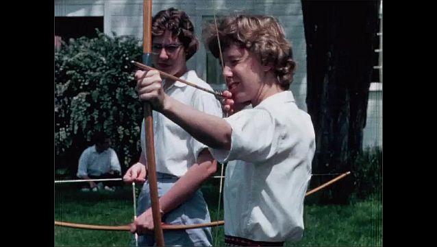 1950s: Men run hurdles. Men play baseball. Women shoot arrows and ride horses.