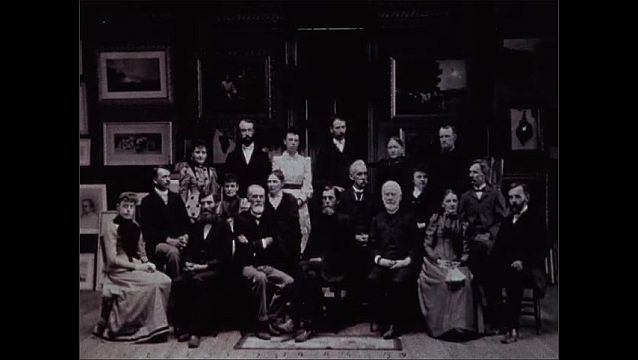1950s: Old photograph of men. Bible pages. Photograph of large group of men and women. People walk into brick building.
