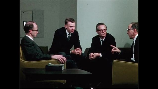 1950s: Men stand in group and talk. Men sit on couches, talk. Man and woman sit together in lab.