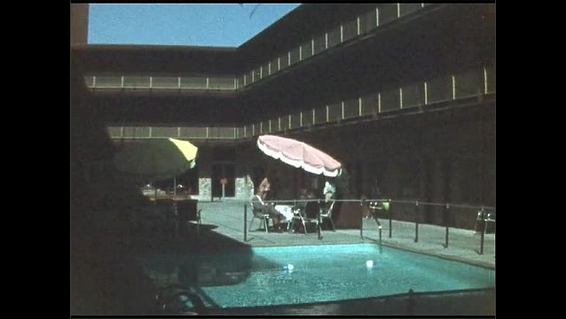 1940s: UNITED STATES: view of diners and hotel pool.
