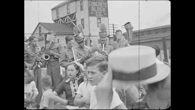 1940s: UNITED STATES: musicians play at baseball match and fair. Brass band play outdoors