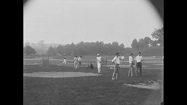 1920s: NEWARK, NEW JERSEY, UNITED STATES: lady plays on golf links at Weequahic Park. People on sports field.
