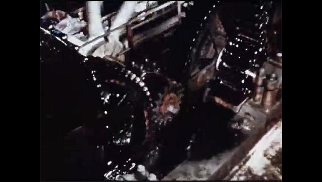 1950s: UNITED STATES: wear and tear on machine. Cogs and wheels turn in machine