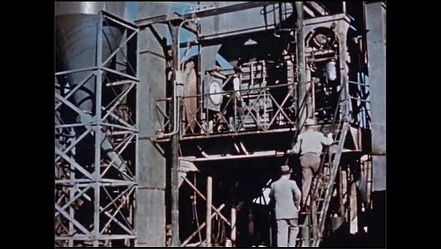 1950s: UNITED STATES: men at oil refinery.