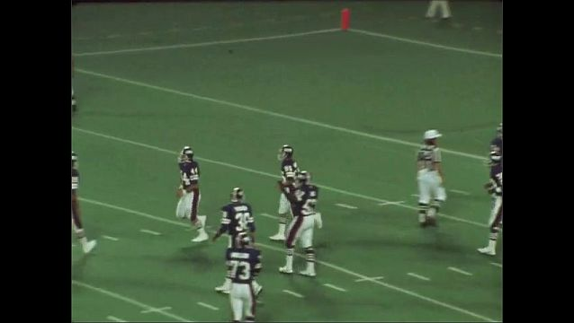 1970s: Football field. Post touch down, player 44 runs out of end zone and embraces teammates. Field goal kick.