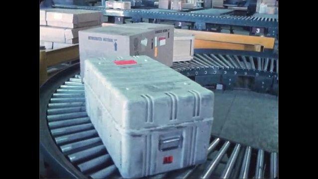 1970s: Boxes on conveyor belt.