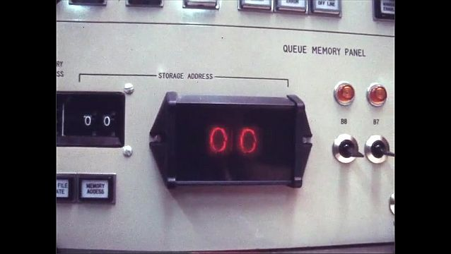 1970s: Close up of digital counter, tilt up control panel.