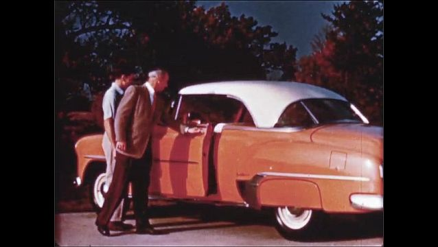 1940s: Close up of car seat. Men walk to car, open car door, zoom in on car. Front seat of car, tilt up.