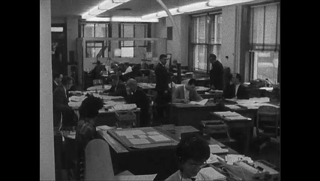 1950s: men in office typing and reading