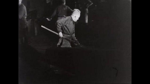 1940s: Men work in steel rolling mill.