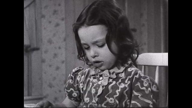 1940s: Child eats. Woman grimaces.