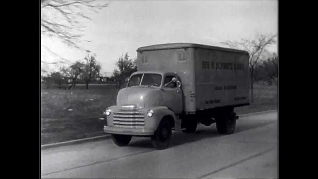 1940s: Truck drives down city street and highway.