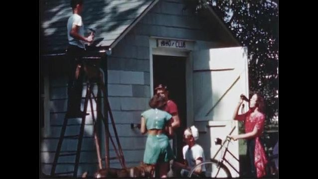 1940s: UNITED STATES: young people fix up old shed for club house.