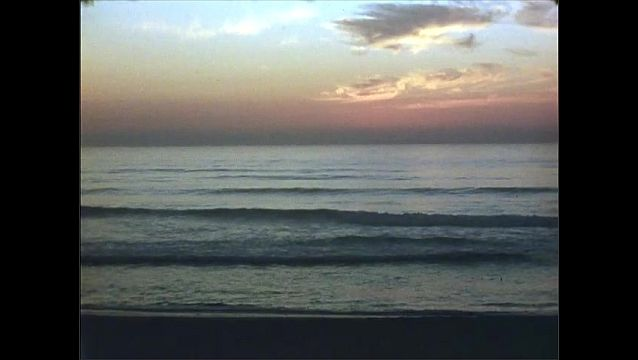1950s: View of sunset. View of ocean.