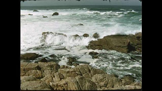 1950s: Ocean crashes into rocks.