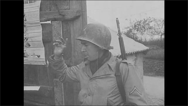 1940s: Soldier turns in ballot, holds up hand, swears in front of other soldier. Election day banners and posters.