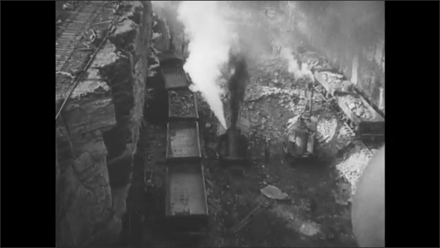 1910s: Smoke rises from industrial factories. Smoke rises from excavating machines digging trench. Explosion in the ground.