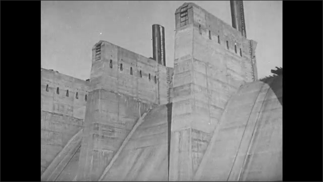 1910s: Dam under construction on large, industrial site.