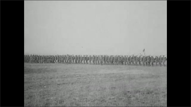 1910s: officers on horses overlooking soldiers in formation