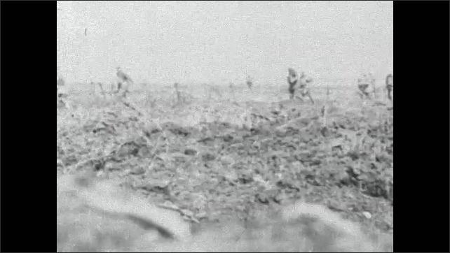 1910s: Intertitle card. Soldiers run across field.