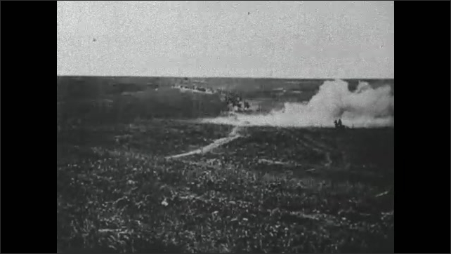 1910s: Men ride horseback across field. Explosion and smoke. Man runs across field.