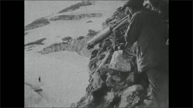 1910s: Landscape. Intertitle card. Soldiers march up mountain pass. Soldiers fire guns from up high on mountain. Intertitle card.