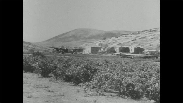 1940s: bombers landing on landing strip