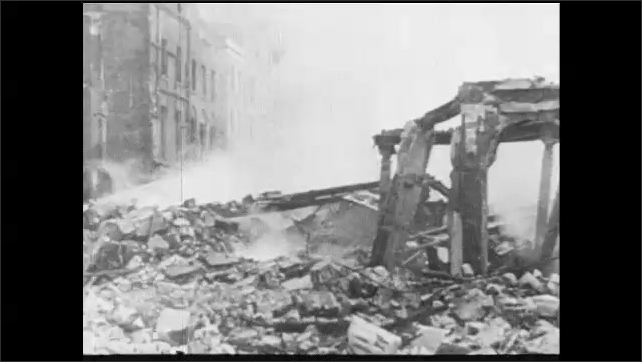 1940s: artillery fires, smoky explosion, smoke and flames over city rooftops, rubble and twisted wreckage in city, peaceful street with church, city street with traffic
