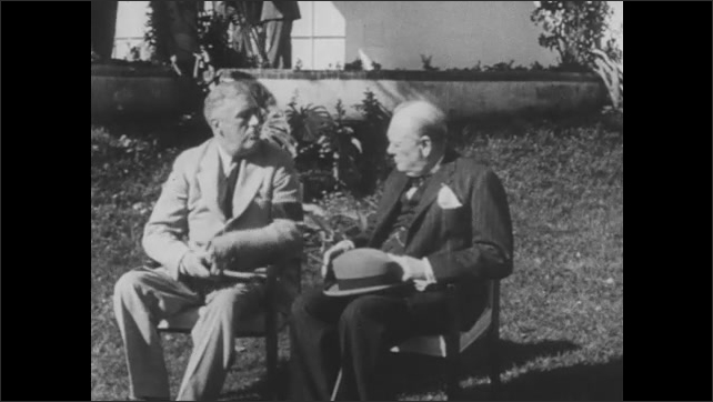 1940s: Men in uniform sit at table, talk to one another. Winston Churchill and Franklin Roosevelt sit outside and talk. Cars drive across bridge in London.