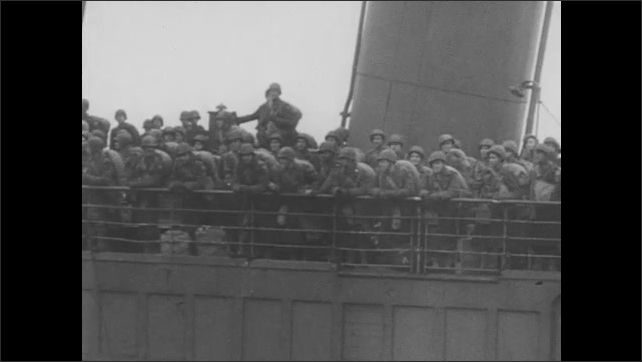 1940s: Gunmen shoot at other planes in the sky. Transport ship carries soldiers overseas. Soldiers disembark from ship.