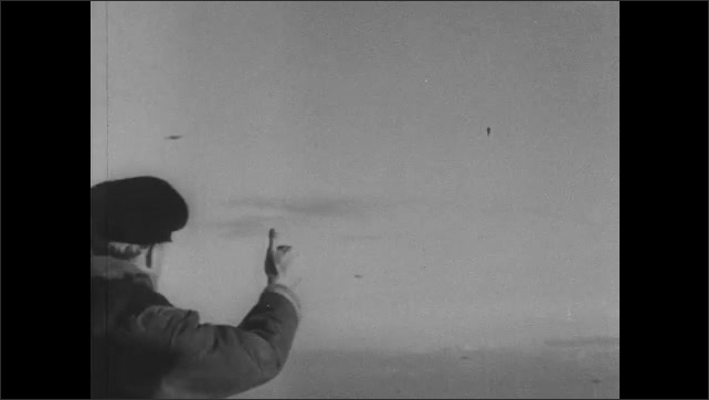 1940s: Planes fly through sky. Soldiers look up. Soldiers ride in planes.