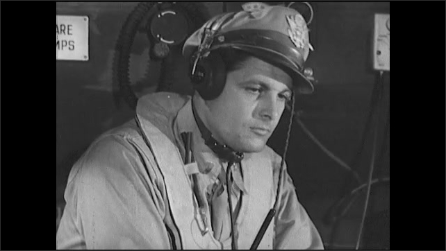 1940s: Pilots strap on seat belts and talk in cockpit. Communications officer secures bags under console.