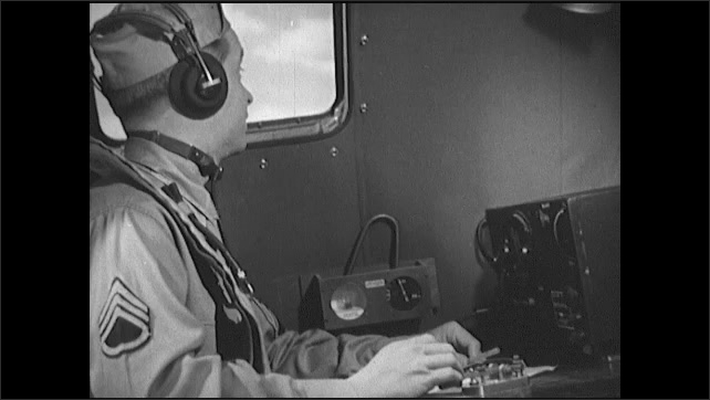 1940s: Soldiers gather in communications room on bomber. Officer and pilot sit in cockpit and talk. Radio operator looks out window. Officer sits in cockpit and talks.